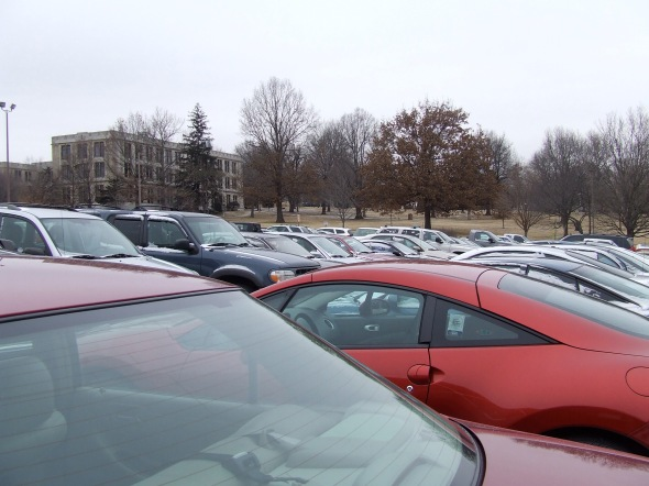 This is my parking space today. Beyond the sea of cars is the building where my class is. Can't see it? Look through the trees with your X-Ray vision, in the very center of the distance. That's where I'm headed.