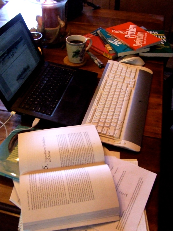 nine textbooks (all purchased), my computer, highlighters and the ever-present cup of coffee.